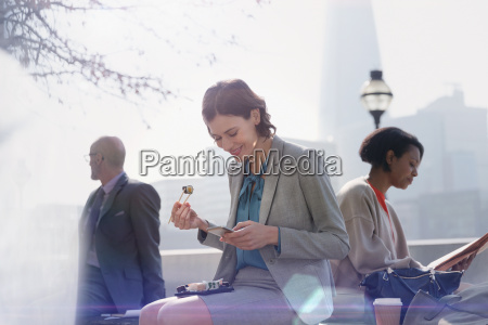 businesswoman eating sushi on lunch break