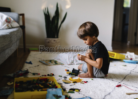 young boy with brown hair sitting