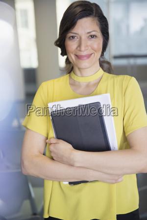 portrait smiling confident businesswoman with digital