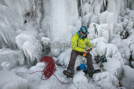 view of climber with equipment sitting