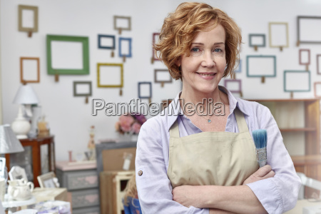 portrait smiling mature female artist in