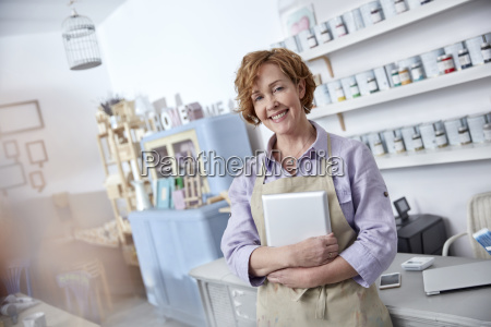 portrait smiling confident female business owner