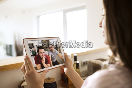 young woman using tablet for video