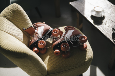 roller skates on a chair in