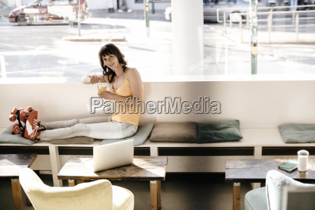 woman wearing roller skates sitting in