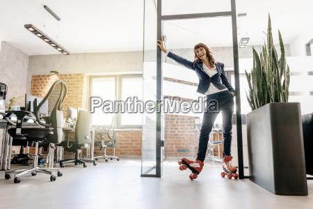 successful businesswoman wearing roller skates in