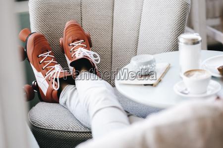 woman, wearing, roller, skates, sitting, in - 22933233