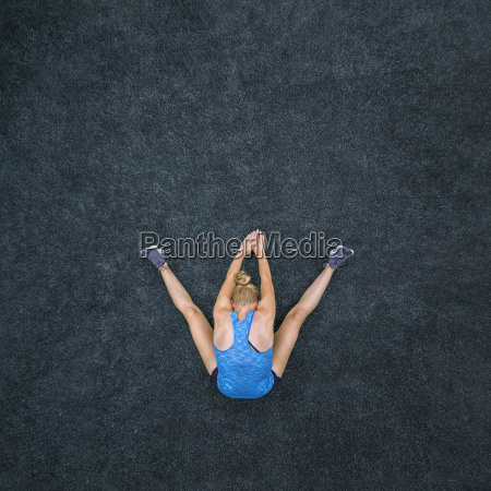 young woman doing gymnastics top view