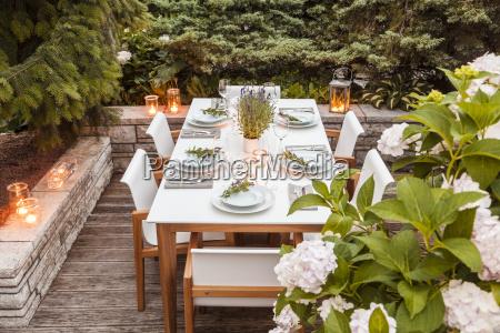 festive laid table on terrace