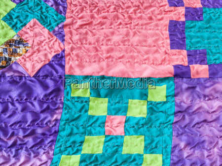 square pieces of fabrics in stitched