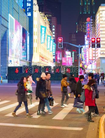 people cross shanghai road china