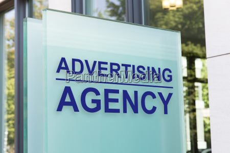 advertising agency sign on glass board