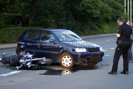 policeman picks up motorcycle accident after