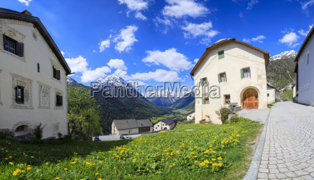 panorama of alpine village framed by