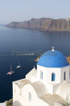 white church with blue dome overlooking