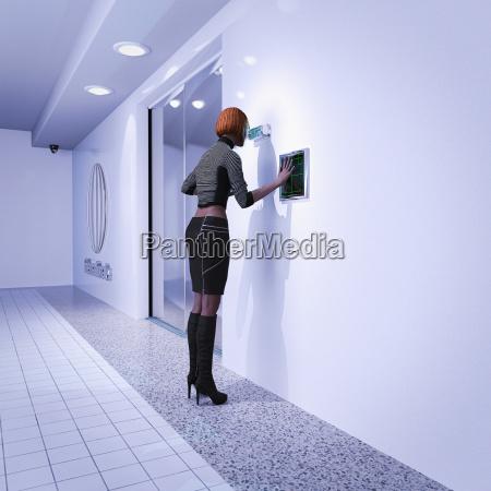woman using biometric scanners in futuristic