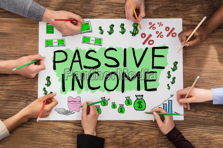 group of people drawing passive income
