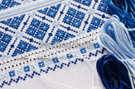 handmade embroidery by white and blue