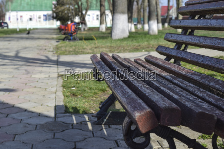 a brown bench in the park