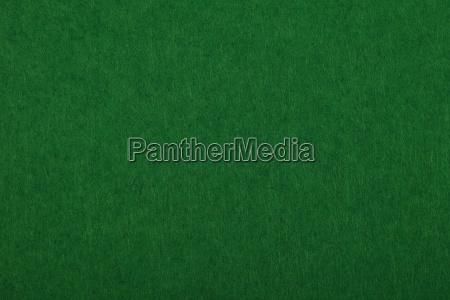 dark green felt background texture close