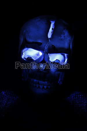 plastic human skull with blue illuminated