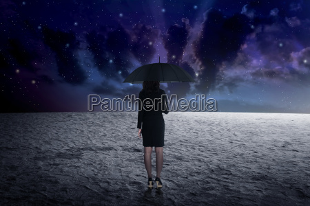 man holding umbrella from outer space