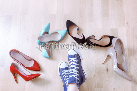 pair of sneaker surrounded by elegant