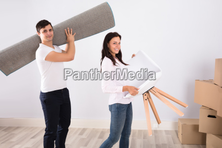 couple carrying furniture