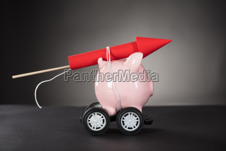 rocket firework tied up with piggy