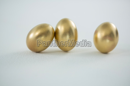 golden easter eggs on white background