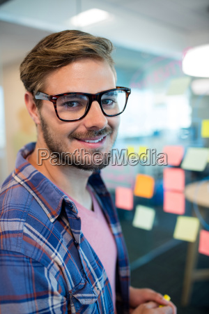 man in office standing near the