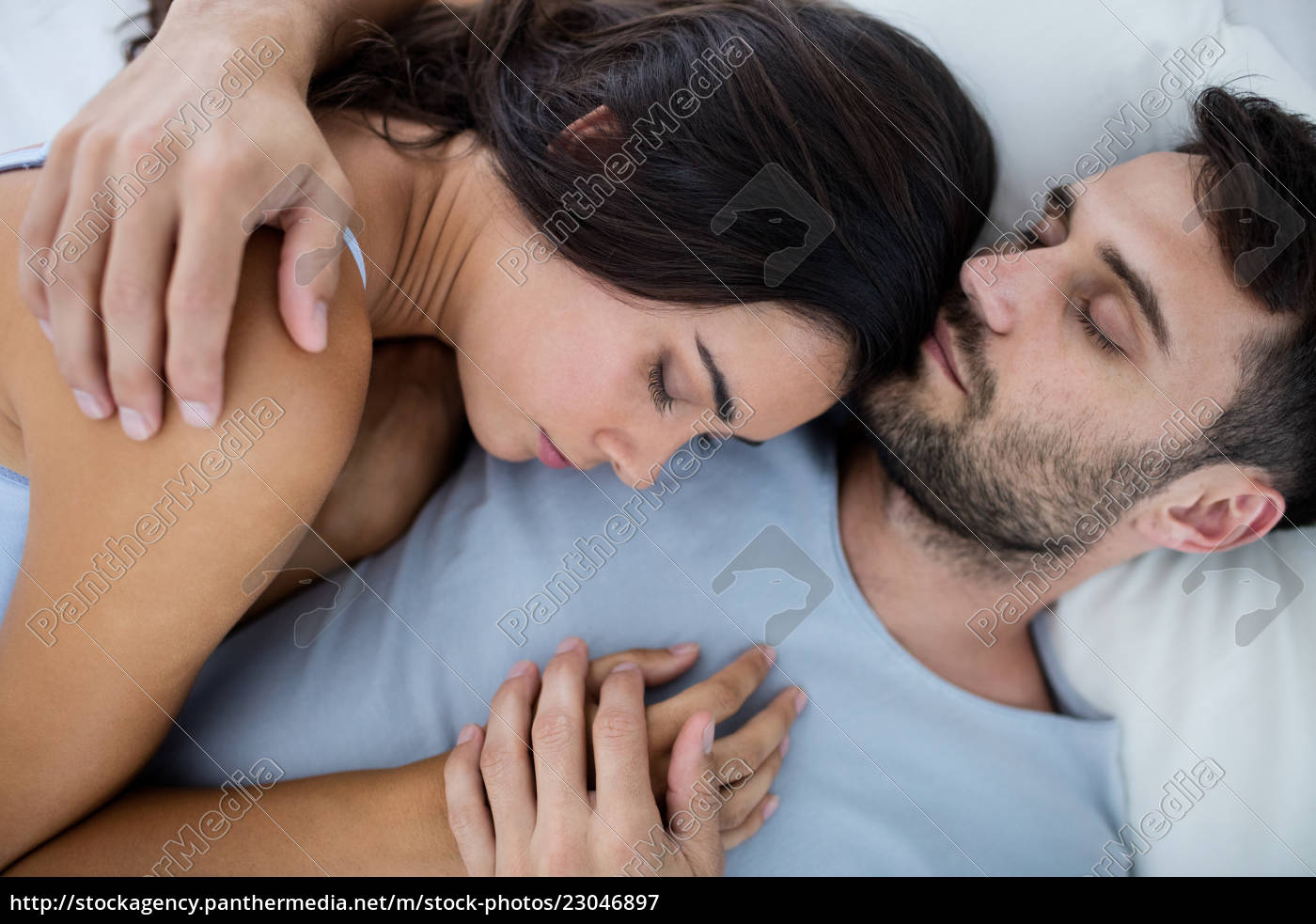 Young romantic couple sleeping on bed 23046897