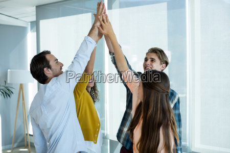 creative business team giving a high