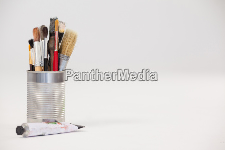 varieties of paint brushes in metallic