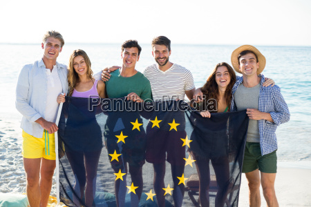 friends holding european union flag on