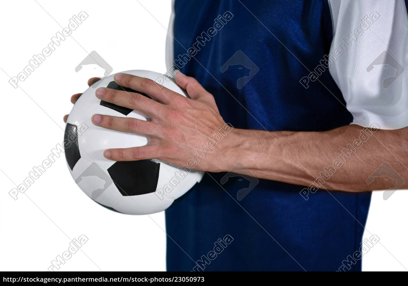 mid-section, of, football, player, holding, football - 23050973