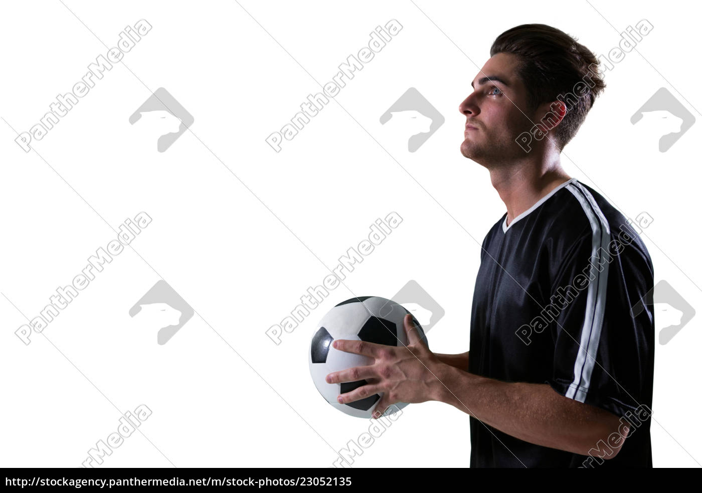 football, player, holding, football, with, both - 23052135