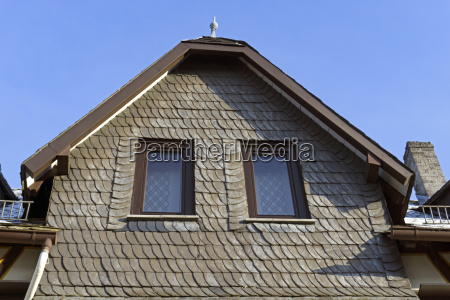 old house facade with slate shingles