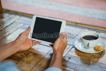 cropped image of man holding tablet