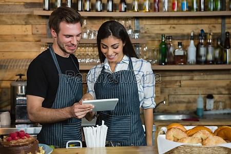 waiter and waitresses using digital tablet