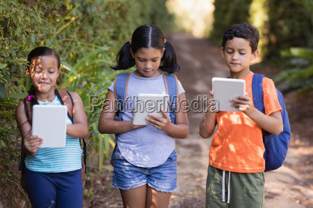 boys and girls using digital tablets