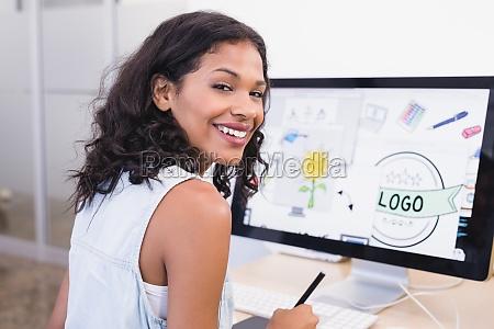smiling businesswoman using desktop computer