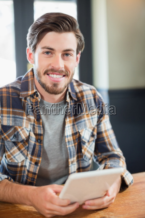 handsome young man holding tablet pc
