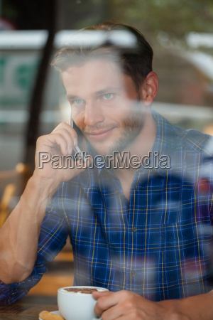 handsome man talking on mobile phone
