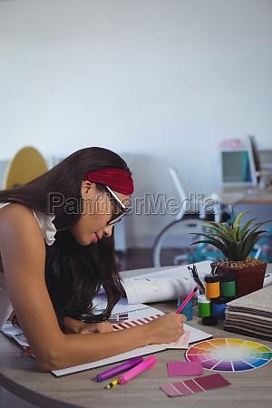 businesswoman working on desk at creative