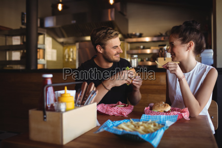 happy couple interacting while fast food