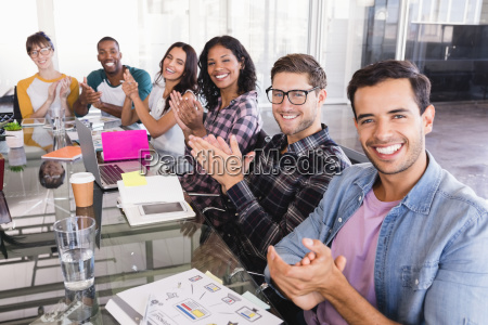 portrait of business team clapping while