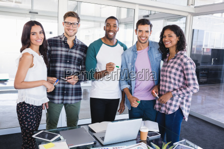portrait of young business team standing