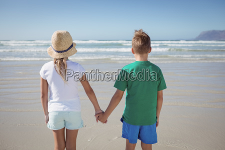 rear view of siblings holding hands