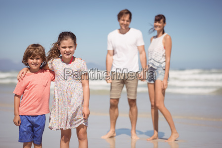 portrait of smiling siblings standing with